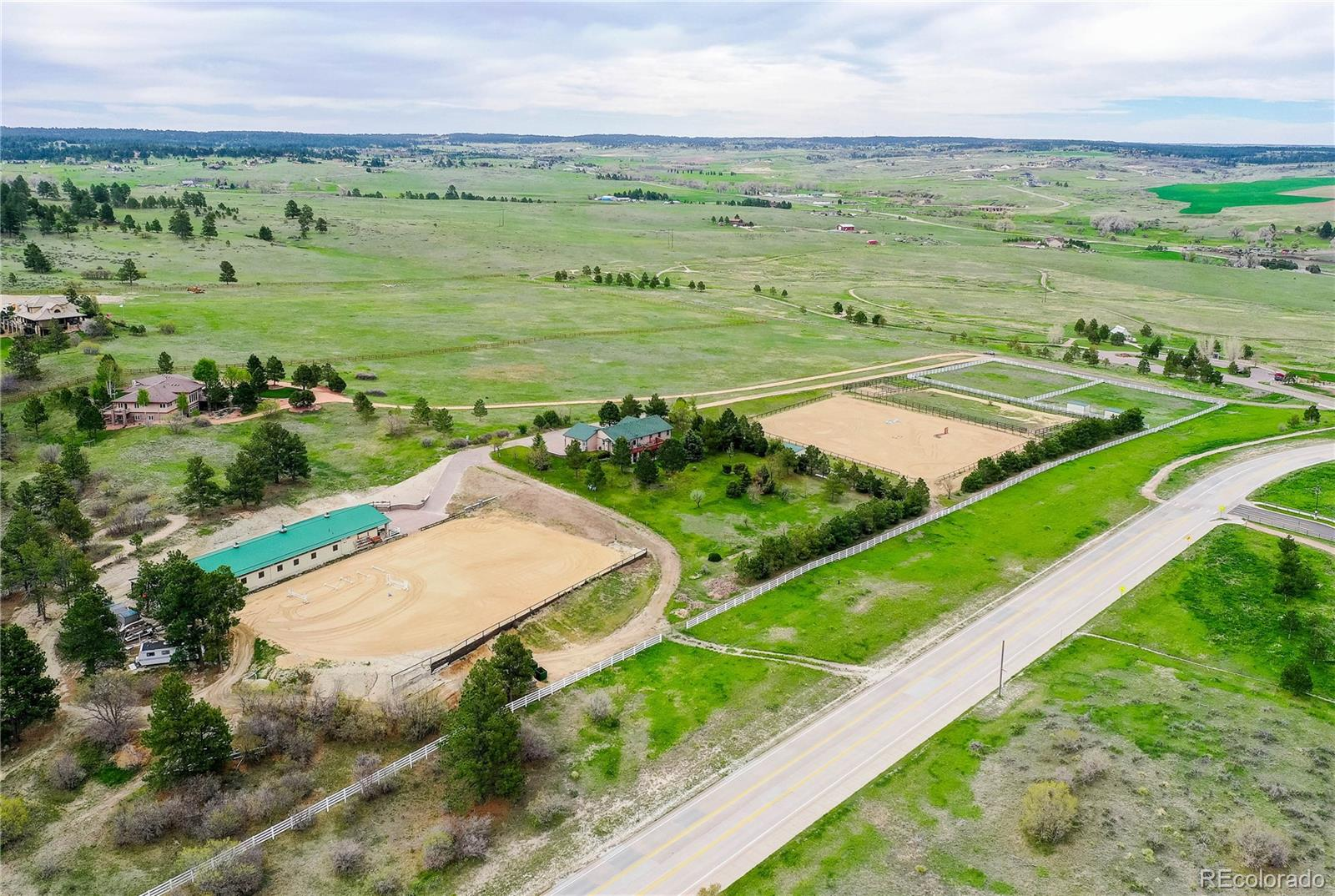 10 Acres of pure heaven. Have horses? This property can legally accommodate up to 20 horses. The gigantic all brick stables with 14 stalls, tack room, 4 more stalls for grooming plus a groomer suite is just a few hundred yards from Colorado Horse Park. Two larger outdoor arenas... 6 good sized paddocks plus 2 large paddocks with power and water...fully fenced. There is a covered area for hay storage and space for RV storage. Oh... and there is a great house on this property... a well maintained Ranch style with full finished walk out basement... hundreds of trees... extreme mountain views... far enough away to enjoy the lifestyle, yet close to all that Parker offers.