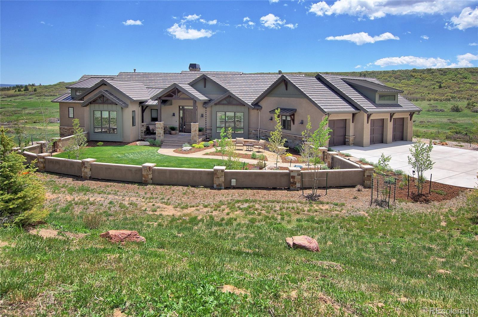 Your once in a lifetime dream home is now available! Multiple award winning 2018 Parade of Homes model built by luxury builder Comito Building and Design. Perfectly situated above cascading beaver ponds and Bristlecone Lake on a private 1.43 acre Forest Lakes Estate lot. Incredible unobstructed mountain, valley, stream and lake views. This home delivers the best of Colorado lodge living. The positioning of the home takes full advantage of gorgeous sunrises and sunsets. From the moment you visit this home you will be impressed by the attention to detail, exceptional design and unsurpassed quality inside and outside. Main level living at its finest with an open and inviting feel. Just a few of the many amazing features include solid alder wood doors, pecan wood floors, custom hand painted walls, Pella windows with built in blinds, custom woodwork, vaulted wood beam ceiling, gorgeous granite and tile, impressive lighting, professional grade Wolf and Subzero appliances, induction cooktop, steam oven, cantina sliding window system which opens the kitchen to the deck, amazing wet bar, extensive use of beautiful stone and many more spectacular features. The elegant master suite includes a walkout to the deck, luxurious master bathroom and huge custom closet. The rock surround wet bar near the rec room is perfect for entertaining friends. There are two charming suites in the basement with their own impressive bathrooms. Sip wine on the covered deck and listen to the peaceful sounds of the flowing creek and waterfalls while enjoying the mountain, lake and wildlife views. The deck includes a fire pit table and 2 infrared heaters to keep you warm on those cool Colorado evenings. If you choose to unwind and relax after a long day there is a private hot tub just outside the walkout basement. You have to see this home to believe all of the custom features it has to offer! The homeowners have lovingly cared for this home and it shines. Prepare to fall in love. Welcome home!