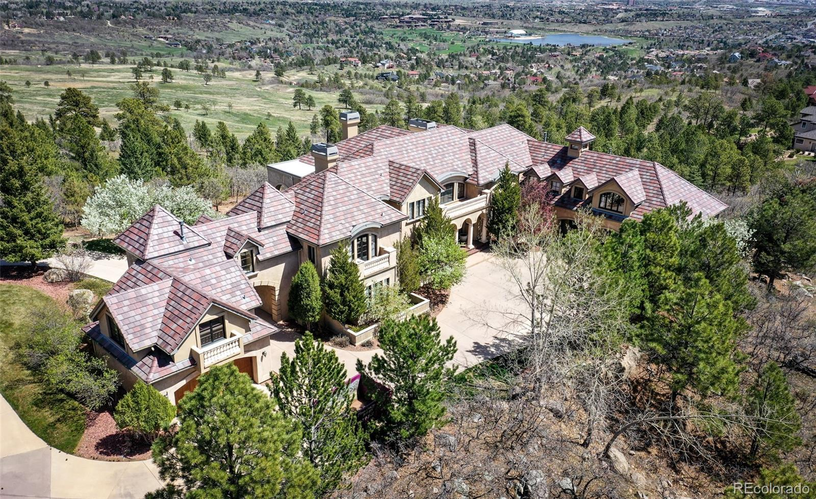 Stunning custom mansion on private 1.35 acre lot at the end of a quiet cul de sac in gated & prestigious Broadmoor Resort-Sweeping, unobstructed 180 degree city, lake & mountain views from every level-Over 14,000 sq. ft. w/ a great floor plan for some serious entertaining & or extended family living-20ft. custom ceilings on main level-10ft ceilings in basement-4 newer furnaces & central air conditioners-2 newer humidifiers + 3 newer hot water heaters-Custom 20ft ceilings on main level-Custom window coverings-Angles, arches, pillars & hand troweled walls-Surround sound on every level-Walkout basement-Security system w/ cameras-New cement tile roof.