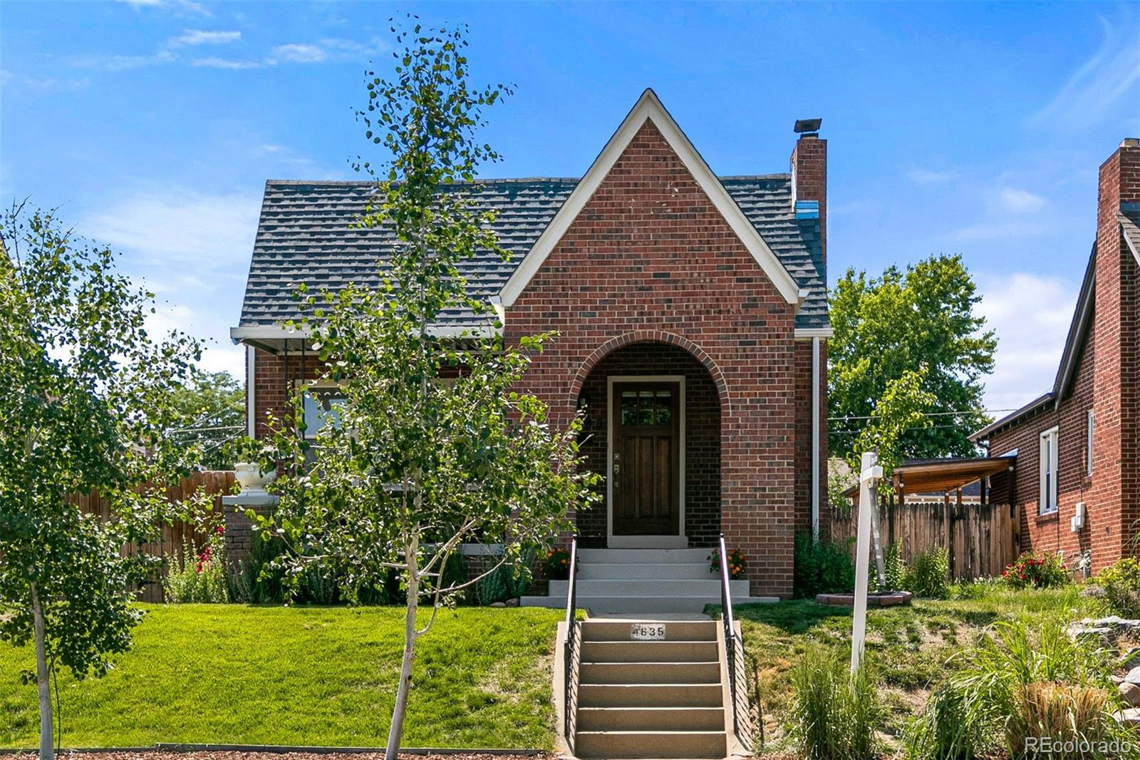 Is city life calling your name? This contemporary Sunnyside Tudor is ready for your personal touch. The main level boasts a sizable living area and showcases an updated kitchen with modern white cabinets, Carrera countertops, and stainless-steel appliances. The finished basement offers two conforming bedrooms, a sizable adjoining bathroom, and additional living space. Recent upgrades include fresh interior and exterior paint, an impact-resistant roof, double-pane windows, central AC, and plank vinyl flooring in the basement. Kick back and enjoy endless sunsets and star-lit nights in the private, tastefully landscaped, west-facing backyard. True value shines through with proximity to Rocky Mountain Lake Park, multiple shopping districts, restaurants, coffee shops, Downtown Denver, and the Rocky Mountains. Do not miss the opportunity to schedule a tour today! A 2-10 Home Warranty will be purchased on behalf of buyers and included upon successful closing.