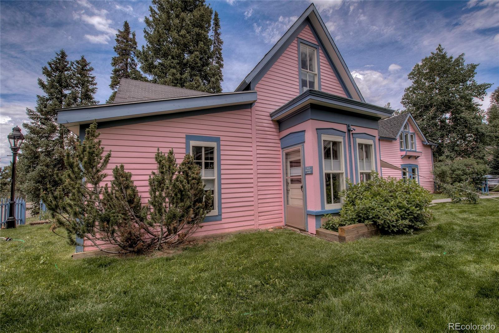 Rare opportunity to own the iconic and historic 'pink house' in Breckenridge. A mainstay of the community since 1900, now offered as a fully furnished, turnkey rental in the heart of downtown Breckenridge. Extensively remodeled historic former B&B that lives like a single family OR a single family with a mother-in-law suite OR a duplex. Choose your highest and best use at your convenience! The 2 bedroom side of the property was previously long term rented for $3000 a month and could get more income if you choose. 1031 Exchange eligible with tons of potential and versatility. Short Term Rental projections from a local and reputable management company show the potential of $155,000 Gross Income. Use one side while you rent the other side out. Rent out the whole thing while you're away. Or just keep it all for yourself! Serene setting walking distance to all things Breckenridge. Walk to Main Street Breckenridge, shuttle bus to slopes, Breckenridge Elementary school, sledding hill, dog park, and more! Enjoy an evening out on the town, or a day on the slopes, without needing your car. Fancy a mountain bike or road bike ride? Go out the back door to one of many beautifully challenging courses, for miles and miles all day.  Breathtaking and world class birding, golfing, tennis, photography, fishing, shopping, dining, live music, hiking, and of course skiing and snowboarding are all waiting for you, and this home is in the middle of it all. With a big fenced yard, cool evenings under the stars await you and your guests for fun around the campfire. This house has been lovingly restored and updated to modern tastes and standards, and is awaiting your personal touches. When you arrive in the mountains, and make it to this home to Breckenridge, you will be amazed at the endless opportunities to make timeless memories with your loved ones.
