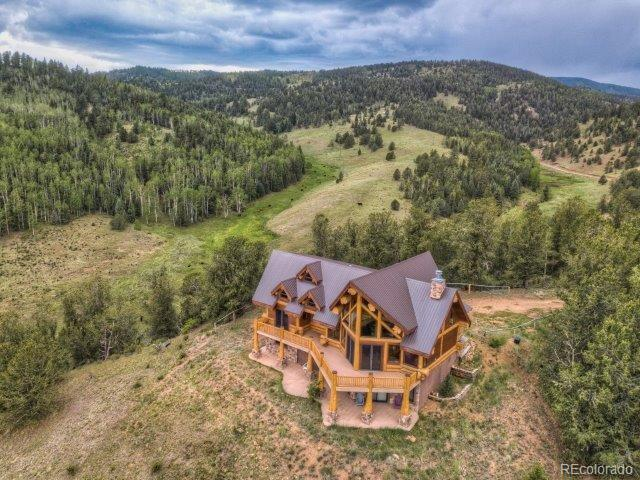 """Impressive Custom Log (Western Red Cedar) on a Spectacular """"One of a Kind"""" Setting Bordering Skagway Reservoir State Wildlife Area & BLM Lands ~ Trophy Hunting, Fishing & Boating ~ Stunning Reservoir and Mountain Views ~ Open Floor Plan, Vaulted Ceilings, Gourmet Kitchen w/Alder Cabinets, Rustic Edge Granite, Italian Stone Farm Sink, Walkout L Level ~ (2) Decks ~ Covered Patio w/ Hot Tub ~ Property is Being Sold Turn-Key and includes all furniture and furnishings and kitchenware ~ A Trophy Property Nestled in Mountain Splendor w/ Exclusive Privacy!"""