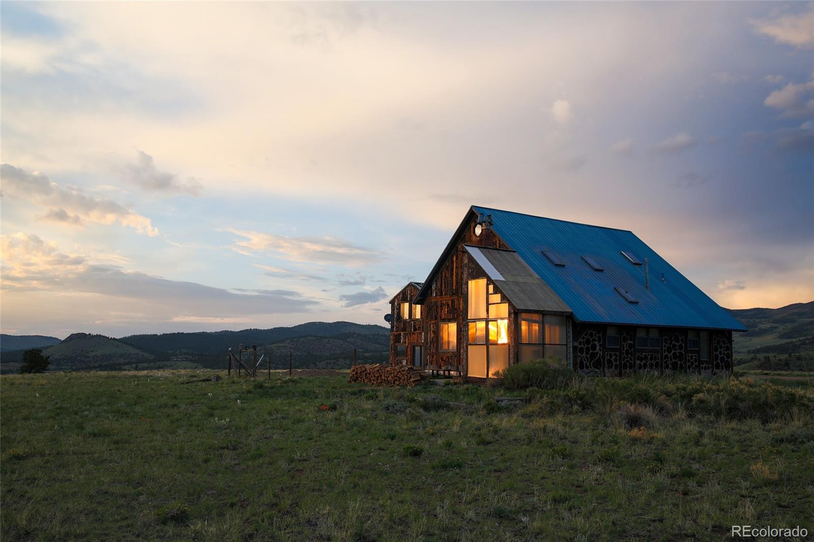 Your opportunity to make this artist home on 35 acres into your dream get-away! This off-grid home is powered by solar and comes complete with a welcoming second guest apartment. The mountain views from this home are jaw dropping! Heated by Wood Stoves, Propane and Passive Solar. Located in the RR Ranch (Double R Ranch) community with only 8 other properties, providing you with quick and easy community access to the National Forest.  Stepping into the charming main living space is warm and inviting. Unique artist touches add to the welcoming appeal of this mountain get-away.  Thinking self-sufficient homestead or small ranch? Chickens, Horses and personal-use live stock (except swine) are allowed! RV parking. Plenty of room to build your barn or green-house and have a self-sufficient homestead.  Astrotnomist and hobby star gazer dream property! This property is located between two mountain ranges in Westcliffe Colorado, a registered Internetional Dark Sky Community where the night sky views are protected from neighboring city light pollution. The night sky views from this home are world class SPECTACULAR!  Thinking VBRO?  This property is currently a VBRO short term vacation rental. Custer County is a VBRO friendly county. (Please inquire for available information.)  Please note that this home has additional construction needs. The main section of this house (Section A) and the apartment (Section C) are approximately 95% or more complete and move in ready, the remaining sections are in various states of repair and completion. Please see floor plan and agent notes for more information. Possible owner financing to a well qualified buyer. 3D TOUR & FLOOR PLAN HAS BEEN PROVIDED FOR THIS LISTING. MOUNTAIN VIEWS - GOOD PRODUCING WELL (5.5 GALLONS PER MINUTE) - WORKSHOPS - LOTS OF ROOM TO EXPAND  Disclaimer: All statements believed to be accurate but must be verified by purchaser.