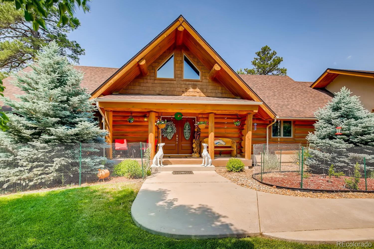 PRICE REDUCED! Close in horse property. Colorado living at its best. Beautiful Fawn Meadows ranch features 3 bedrooms (1 main / 2 conforming basement), 3 baths, great room, kitchen, finished walkout basement and 3 car garage located on over 9 acres.  Peaceful country living.  This lovely log home has been meticulously maintained – pride of ownership shines throughout. Country charm abounds with exposed logs, vaulted wood ceilings, hardwood floors and more.  Beautiful views from the master bedroom and around the property.  Relax on the wraparound covered deck in your own personal oasis.  This home is a must see.  The open kitchen is perfect for entertaining and features stainless steel appliances and a gas cooktop, breakfast bar and dining area.  The many windows allow the natural sunlight to cascade in – bright and cheerful.  Enjoy gardening in the beds or strolling through the mature pines.  The finished walkout basement is perfect for guests or that teen wanting their own space.  The spacious barn has many possibilities and would make a great workshop.  This home lives large.  Close to the town of Elizabeth, providing easy access to dining, shopping, entertainment and other amenities.  Don't miss your opportunity to own this spectacular property.  Domestic Well. Welcome Home!