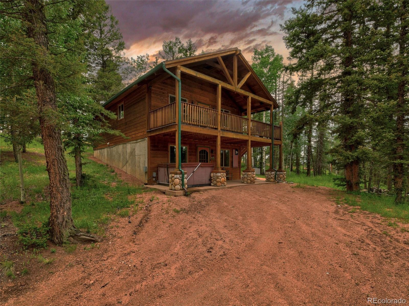 Amazing lakefront mountain cabin in the Heart of Colorado Mountain Estates. This property boasts of a double lot totalling in over 1 acre. The Magnuson Reservoir is right off the front of the property. A couple years ago, the dam broke and drained the reservoir, but the dam was repaired at the end of 2020. In the next year or so the reservoir will return to its former glory of being over 5 acres in size, stocked with fish. The cabin is almost 1600 sq/ft with 3 bedrooms and 2 bathrooms. The main level has a beautiful great room with vaulted ceilings, a beautiful kitchen and dining area. Right off the great room there is a large covered trex deck that looks out on the reservoir. There are two bedrooms on the main level with one bathroom. The basement has a large family room, and an additional bedroom and bathroom. Throughout this home you will notice amazing woodwork from the amazing bears on the deck, to the custom cutouts above each room. This property has been used as a Short Term Rental property sleeping up to 13 people. This is an amazing property you won't want to miss out.