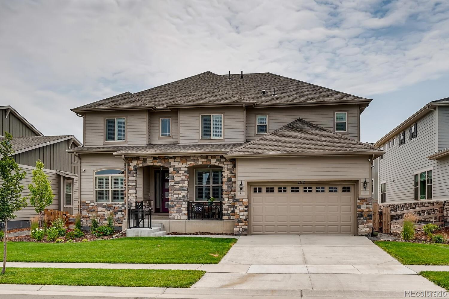 Why wait for new when this stunning home is available now?!  Gorgeous Yuma II 2-story by Toll Brothers features 5 bedrooms (4 upper / 1 conforming bsmt), 4.5 baths (3 upper / 1 main / 1 bsmt), 2-story great room, gourmet kitchen w/spacious breakfast nook, formal dining room, study, finished basement and 3 car garage (2 + 1 tandem). Meticulously maintained - pride of ownership throughout.  This home could grace the cover of a magazine. Beautiful upgrades and finishes including updated lighting, plantation shutters, landscaping, Elfa closet organizers, built in stereo speakers and more.  The finished basement is perfect for guests or teen wanting their own space. Ceiling fans, central air, solar panels, an energy efficient furnace and gas fireplace w/stacked stone surround keep this home comfortable all year long.  The many windows allow the natural sunlight to cascade in - bright and cheerful. Perfect for entertaining inside and out. This home lives large.  Enjoy relaxing on the back flagstone patio or people watching from the covered front porch. Walking distance to Meadowlark school and Star Meadows Park.  Enjoy the walking trails with beautiful mountain views.  Perfect and move in ready. Close to dining, shopping, entertainment and other amenities. Solar panels owned by seller and installed by Namaste Solar. Low HOA. Don't miss your opportunity - Welcome Home!