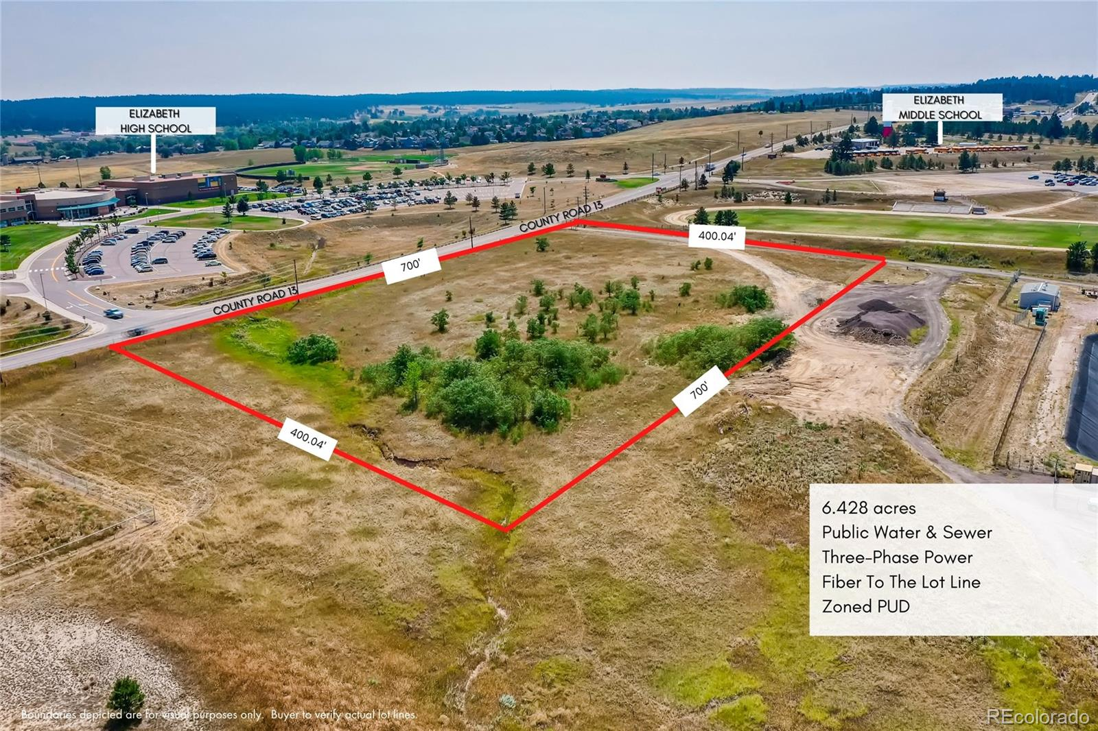 Incredible development opportunity in one of Colorado's fastest growing towns - Elizabeth, CO.  6.48 acres currently zoned PLANNED UNIT DEVELOPMENT, which allows for a MULTITUDE OF USES ranging from RESIDENTIAL, COMMERCIAL, RESTAURANT, RETAIL, the possibilities are endless! You can build a CAR WASH, CO-WORKING SPACE, LIQUOR STORE, GROCERY STORE, STORAGE FACILITY, EVEN POTENTIALLY A CONVENIENCE STORE. The parcel is on PUBLIC WATER & SEWER. Located DIRECTLY ACROSS THE STREET FROM ELIZABETH HIGH SCHOOL and NEXT DOOR TO ELIZABETH MIDDLE SCHOOL meaning you have well over 1,200 STUDENTS & STAFF WITHIN WALKING DISTANCE. What n ideal location for a retail strip! Located just 2500 ft North of the HWY 86 & CR 13 intersection, which currently carries 12,000 cars per day, and is anticipated to carry over 60,000 cars per day by 2040. INVEST IN THE FUTURE!