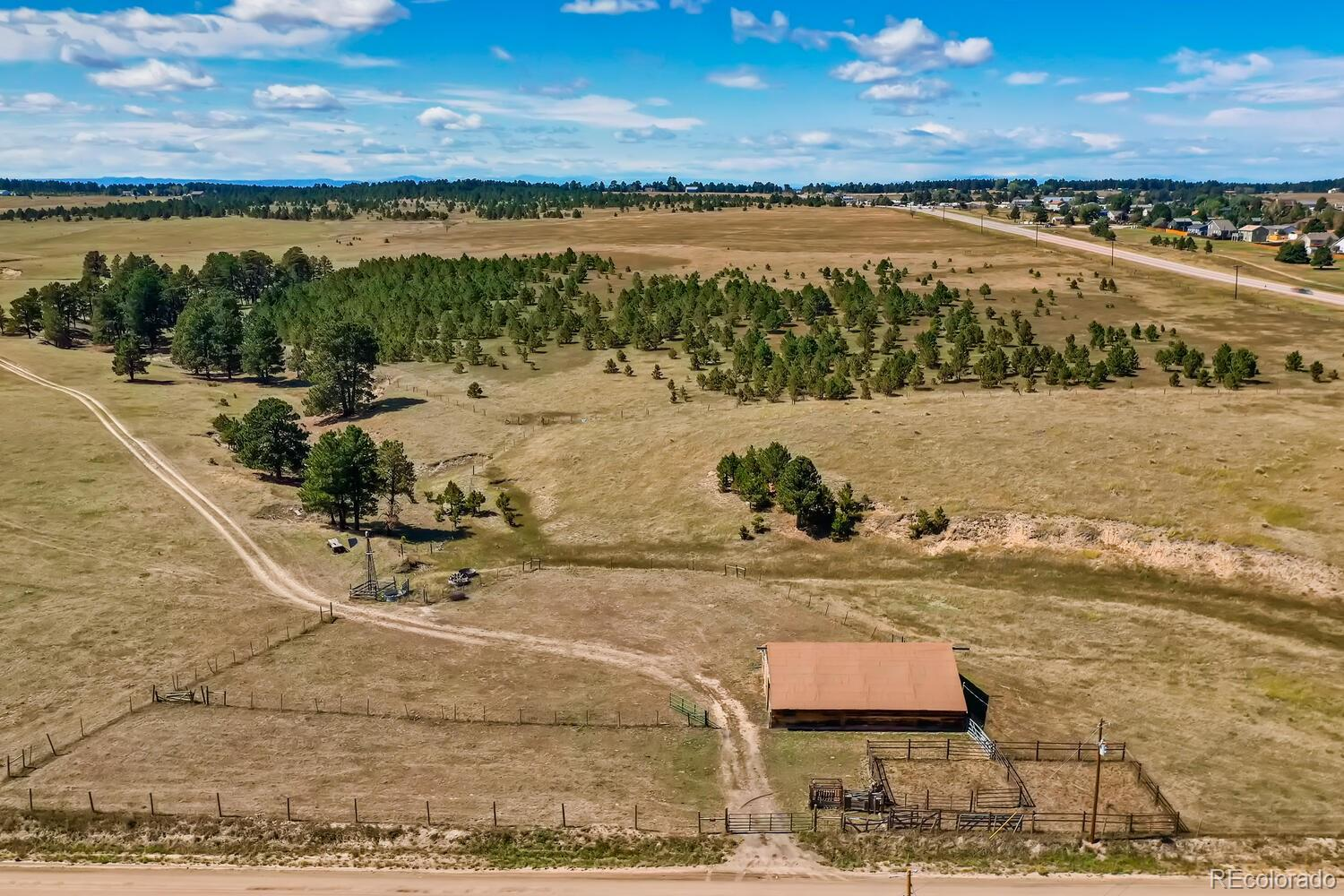 Take a look at this rare acreage near the town of Elizabeth filled with opportunity!  Whether your desire  is to build your dream ranch estate, equestrian center or maintain it as livestock grazing land - this agricultural property is for you.  The land has previously had horses and/or 10 pairs of cattle (10 cows & 10 calves) It is completely fenced and cross fenced with a hayfield that produces 150-200 bales per year (depending on the year), abundant tree grove for privacy from Hwy 86, and grazing area for livestock.  Not wanting to build a ranch estate?  The additional possibilities are endless being located on Highway 86 outside of Elizabeth in the Elbert County Economic Development Zone (EDZ) Overlay, providing the opportunity for commercial development.   (Please visit https://www.elbertcounty-co.gov/documentcenter/view/760 for more information as well as visit Elbert County Building Department for further research).  You will also find that this property is a short distance to the Town of Elizabeth (less than 5 minutes to the heart), 7 minutes to Kiowa, less than 30 minutes to Parker or Castle Rock and approximately 1 hour to Denver International Airport and downtown Denver.