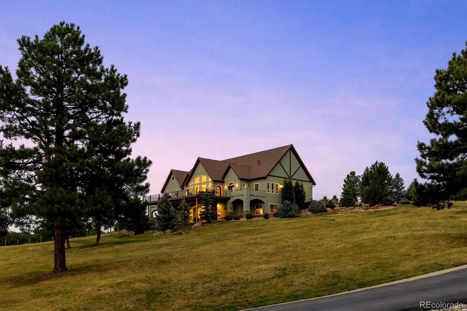 Mountain Living & Luxury at its FINEST! This Hilltop, Gated, Sedalia Home welcomes you to the SHINING STAR of the neighborhood.   3280 Park Ridge Road boasts an 8.86 acre lot, breathtaking views, colorful sunsets, and beautiful wildlife; providing mountain living at its finest in this exceptional, custom-built home. Upon entry, you will be instantly captivated by the hand crafted doors, floor to ceiling windows, dramatic views, massive stone fireplace and gleaming hardwood floors.  Top-of-the-Line Custom Finishes Throughout, Custom Cabinetry, Gourmet Kitchen with Sub Zero & Wolf Appliances, Walk-In Pantry, Granite Counters make the Open Floor Plan Perfectly Designed for Gatherings.  The Main Floor Master Suite features private access to the 1500 Sq Ft Deck, Fireplace, Large Master Bath with His/Her Vanities and Closets, and Private Study/Den with its own separate entrance.  The main floor of the home also features an additional bedroom with ensuite bath, powder bath and large laundry & mudroom.  The finished walk-out basement adds 2 additional large bedrooms, each with walk-in closets and ensuite baths, exercise room and tons of storage.  The large lower level rec room has plenty of space to entertain or relax at home complete with a full kitchen/bar.  Don't miss the front covered patio and firepit, 1600 sq ft barn, the pasture, the sundial patio and the AMAZING Views from the entire property.  Fall in LOVE with this Once-in-a-Lifetime Home!
