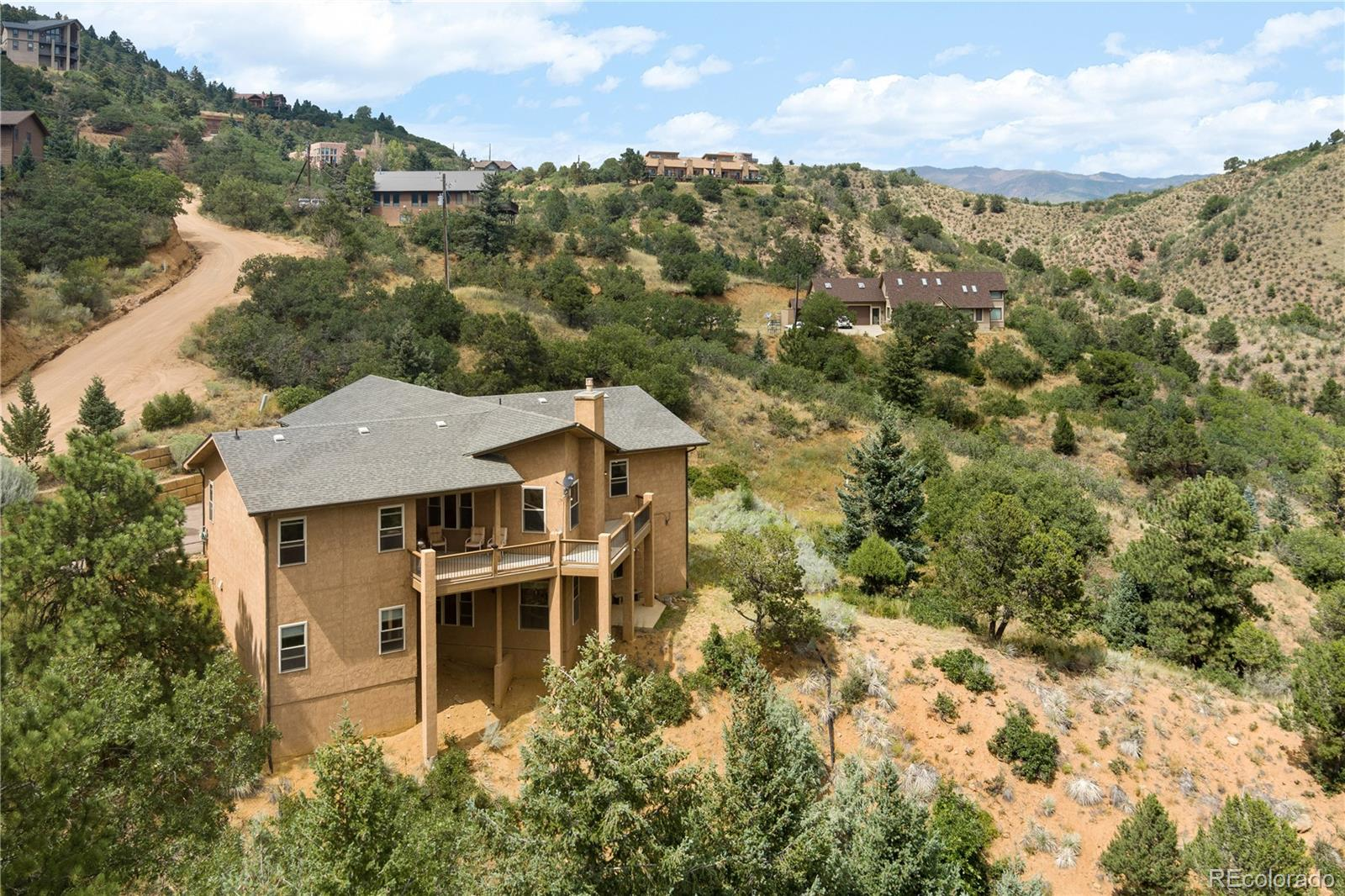 Massive Price Reduction! Welcome to Crystal Park! This is the greatest value for dollar in the whole area. Check out our video! https://youtu.be/ZS9AIw8Z2Uc This prestigious home is a short drive from downtown Colorado Springs but it feels like a world away. The views are spectacular!  Crystal Park's gated community offers so much! A seasonally heated pool, private pond for fishing, and world class views.  The home itself is a very large 4,040 square feet and has amenities like a gigantic walk in closet in the master bedroom, and a stunning back deck area. The home is easily livable in it's current configuration, but if you want to take it to the next level then bring your contractor and plan a brand new kitchen! Act quickly, at this price per square foot we don't expect this one to last!