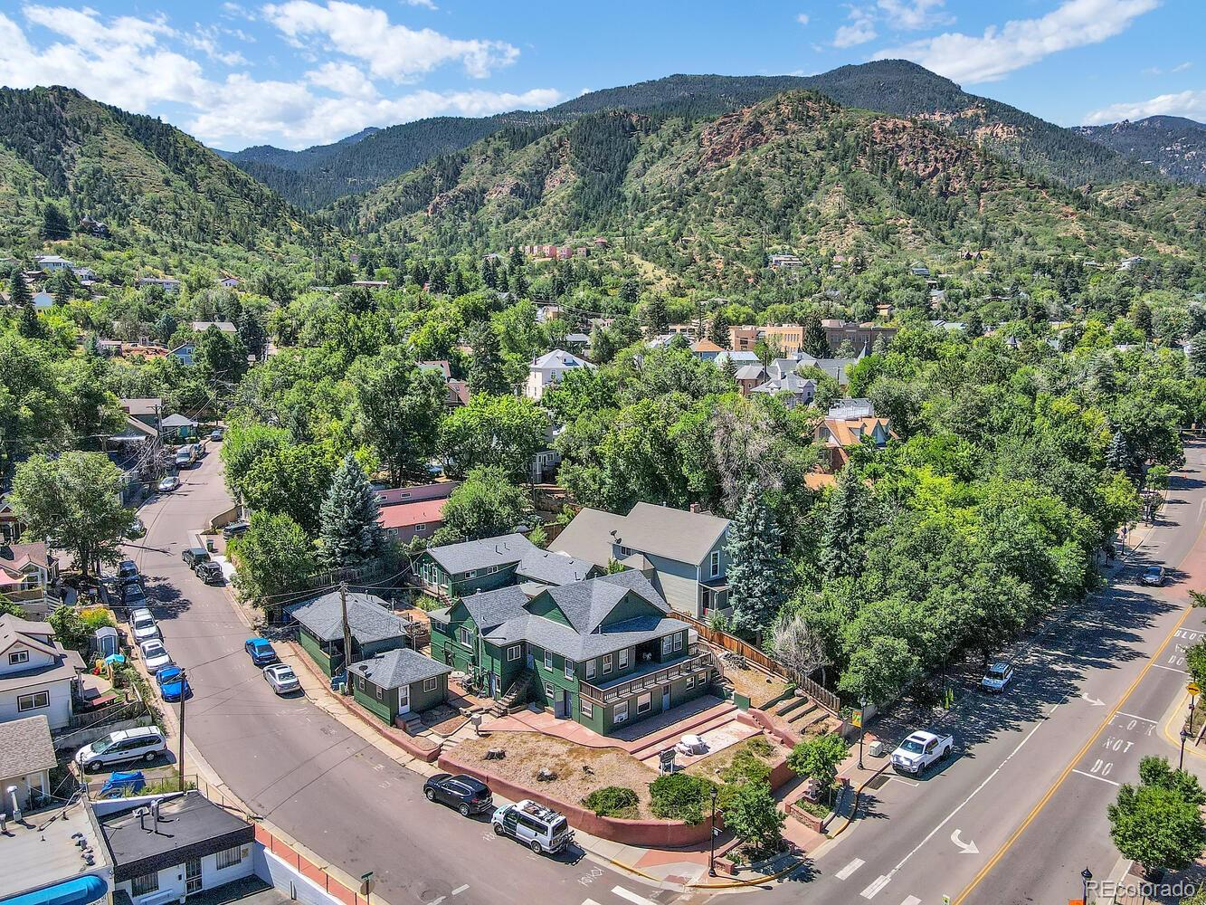 Located in the very heart of Manitou Springs, directly across the street from City Hall. This unique apartment complex features 11 apartments with a variety of 1 bedroom, 2 bedroom, 3 bedroom and studio units. The property consists of 2 studio apartments, seven one bedroom apartments, a two bedroom and a three bedroom apartment. Rent roll is available upon request or through your Realtor. The entire property has been recently repainted, has a newer roof, newer HVAC and recent cosmetic updates in many of the units. Very well kept property with many recent updates and upgrades. This property is professionally managed and never suffers vacancies as the location can't be beat. If you've been looking for a multi family property that is truly turnkey in the heart of a vibrant community here is your shot!
