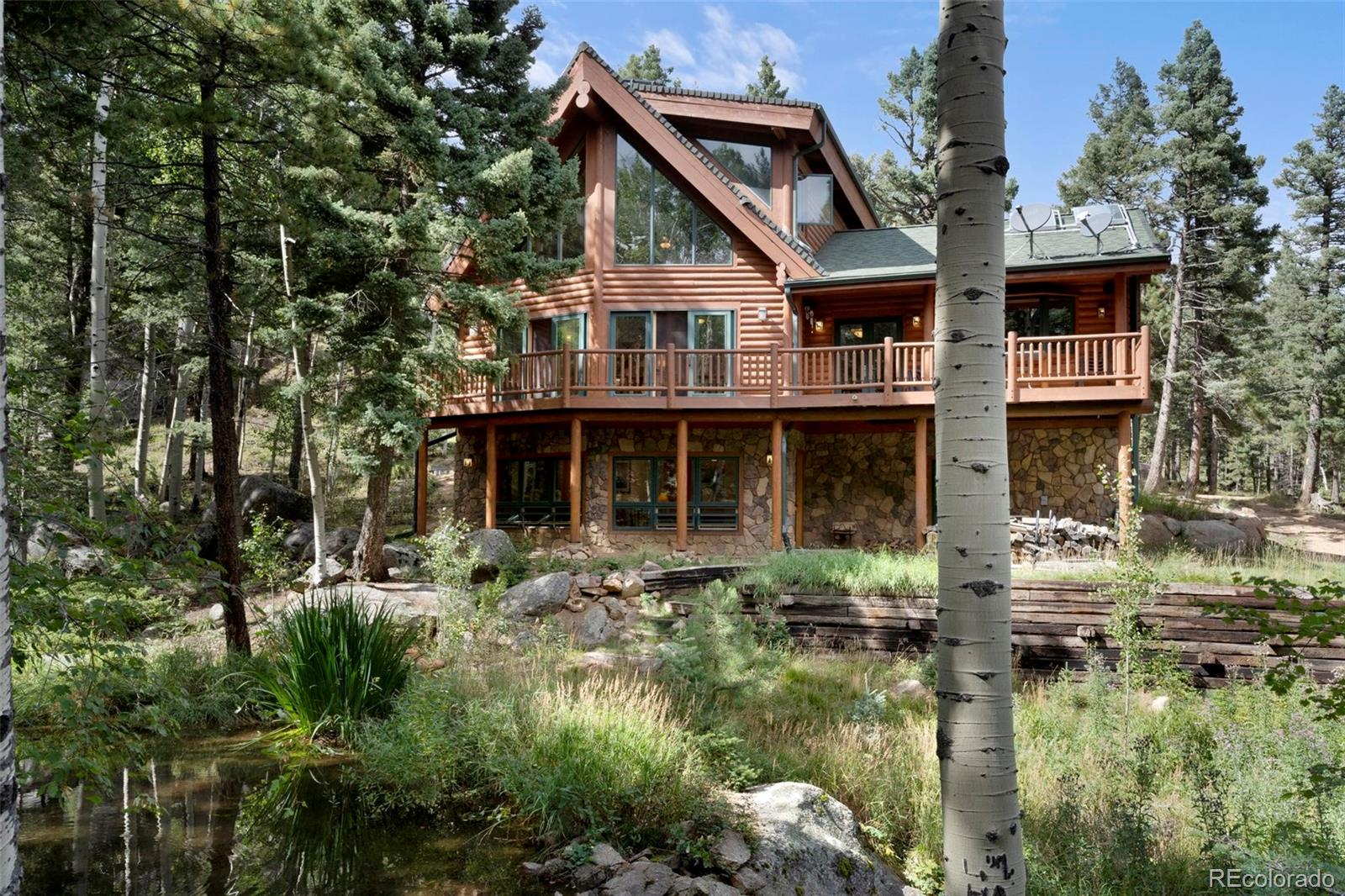 This Extraordinary Log Home, nestled in the Aspen trees above a pond in beautiful Crystal Park. Stunning architecture and mountain character throughout. Gracious Mountain living, blending native materials with modern design elements. Large deck with wonderful treetop views and views of the stream, pond on property. This 3 Bedroom, 4 Bathroom residence includes Gourmet Kitchen with Live Edge Granite Counter Tops, Custom BuiltIn Counter Seating, Custom Tile and Hardwood Flooring with Radiant Heat. Other Features include: Solar Panels, Heated Garage, Newer Furnace, Newer Water Heater, Newer Boiler, Fixed Gas Fireplace, All Bathroom Fixtures oil Rubbed Bronze, Heated Toilet Seats in 3 out of 4 bathrooms, Newer nest System Throughout, Wood Stove in Family Room and much more! This Log Home is the Perfect Mountain Retreat for your family and friends. Enjoy the changing seasons. Mature aspens, pines and wildlife views from every room. Rare Stream and Pond on this private location. Living room features Hardwood Flooring, Pella custom High-Efficiency Windows, Lodi Wood Burning Stove and Cathedral ceilings with wall of windows soaring 2-stories. Gather around the fireplace in the Family room directly off the well-appointed Gourmet kitchen. Attention to detail throughout. Main level also includes Master Bedroom, adjoining 5-piece Bath with Jetted Tub and Large Walk-In Shower…Also on the main is a 1/2  Bath and Laundry. Loft Bedroom includes 4-piece Bath and Separate Sitting Area which creates the peaceful feeling of living in the tree tops. 1,700 sq ft of downstairs living with the 3rd Bedroom, 3/4  Bath, Exercise Area and Walkout to Garden Level and Pond. Watch the birds, deer, turkeys, foxes and more. This true Log home in an absolutely spectacular setting, is worthy of it all! Crystal Park is a private, four-season destination situated on 2,000 acres. Amenities include fishing, Swimming Pool, Guard Gate manned at various hrs, Community Center, miles of Trails, & much more.