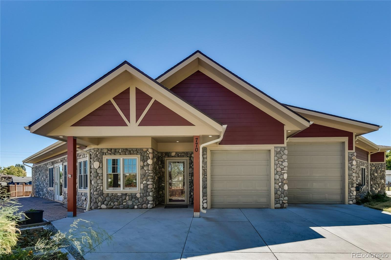 OPEN HOUSE SUNDAY 9/26/2021 1:00-4:00 Rustic/Modern ranch style home. No stairs! 24 Solar panels on roof that are owned. Open floor plan with hardwood floors. 11 foot ceilings. Modern chef's kitchen with floor to ceiling cabinets, large island (with storage) gas stove top, double ovens, prep sink, Quartz counter tops, 3 pantries, stainless steel appliances and light grey cabinets. Living room has a wood burning rock fireplace. Great entertaining home with living room, walk out onto the deck from the sliding glass door and big dining space. Master suite-large walk in closet and master bathroom, has a shower (a small step up) and modern double sinks. Bedrooms 2 and 3 have a full bathroom in between. 4th bedroom up front could also make a great home office. Nice entry with curved wall for art work. Laundry room with a soaking sink, full size washer and dryer. Hunter Douglas blinds on all windows. wrap around decking on the side to the back. Large yard and garden areas. This half duplex is joined by the 3 car garage on both sides. No adjoining walls. 11ft ceilings in the garage with built in mechanics cabinet, 220 Volt plug for an electric car, lots of storage space. Bring your RV and park it outside and use the RV drainage system out front. Large 80 gallon hot water tank, Ecobee Smart Thermostat. Central A/C. This is on a cul-de-sac. Easy access to 6th Ave and I70.