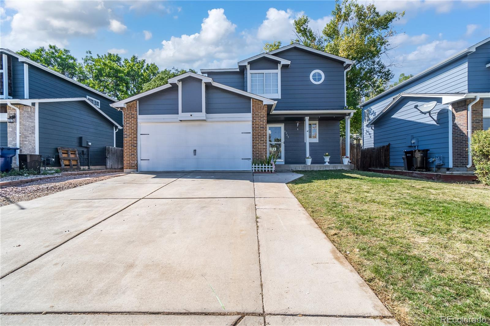 BEAUTIFUL HOME IN HEART OF ARVADA!! The minute you walk in you will fall in love with the bright and sunny open floor plan!!! Beautiful kitchen with granite countertops, stainless steel appliances, plenty of cabinet and counter space. Brand new laminate wood floors on the main level and upstairs bathrooms!! Upstairs features 3 bedrooms including a master suite with his and  her closets, double sinks and an oval tub perfect for those relaxation nights!! New custom tile!! Jack and Jill bathroom for the secondary bedrooms!! You'll love your finished basement with an additional bedroom and office or extra storage room!! Large backyard with covered trex deck!! New flooring, new oven, new lighting fixtures, new doors and handles, new interior paint and new garage door!! Roof is only 3 years old!! This wonderful home is steps away from the community park!! NO HOA!  Centrally located!! Close to schools, restaurants, Olde Town Arvada and all the other cool spots Arvada has to offer!!! Don't miss out on owning this AMAZING HOME!!!