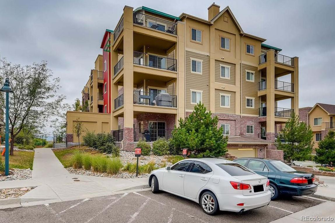 This Clocktower at Highlands Ranch condominium combines modern and easy living with spectacular views of the Denver Metro landscape. Sold Fully Furnished! The bright and open floor plan includes a combined living room and generously sized eat-in kitchen area, that includes top of the line appliances, and sliding glass doors leading out to the large wrap around patio.  There are two bedrooms with new carpet, two updated full bathrooms and an laundry closet that complete this unit.  There is an underground parking space and storage unit which is easily accessed by the elevator.  Just a short walk to restaurants, shops, the beautiful Civic Green Park!