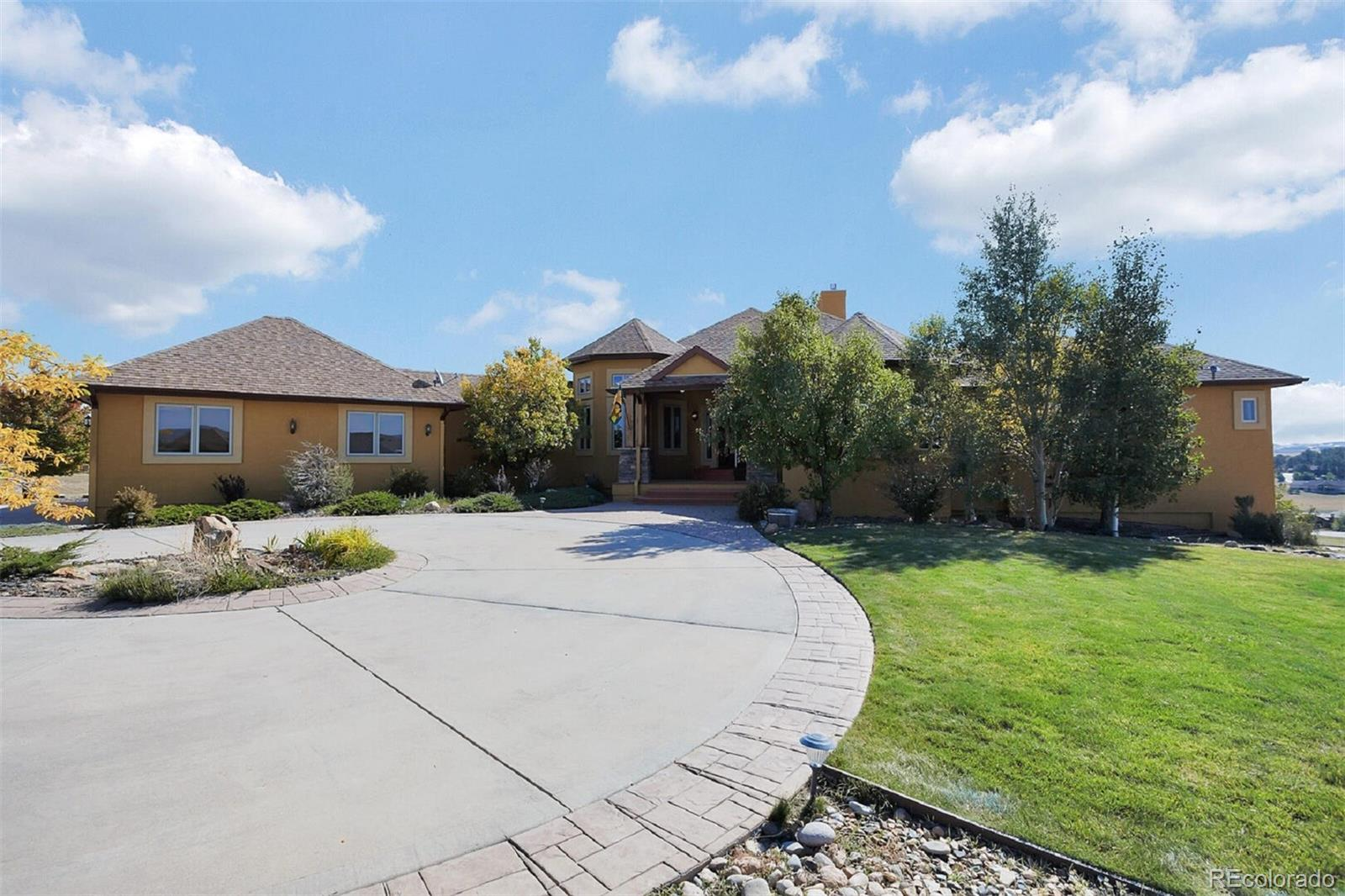 Don't miss this incredible Kings Deer Home with spectacular Pikes Peak views.  Great home for entertaining with amazing indoor and outdoor spaces including a Bocci Ball Court.  It has everything you will ever need, 5 bedrooms, 7 bathrooms, 3-car garage, 2.5 acres in golf-course community. Double-Door entry, large rooms, 3 fireplaces--one is a floor-to-ceiling stone fireplace. Built-in entertainment center, wet bar, trex decking, butler's pantry, workout room with private sauna. Separate golf-cart garage. Gourmet kitchen with high-end cabinets, dovetailed built-ins. Front Range/Pikes Peak views, golf course views.