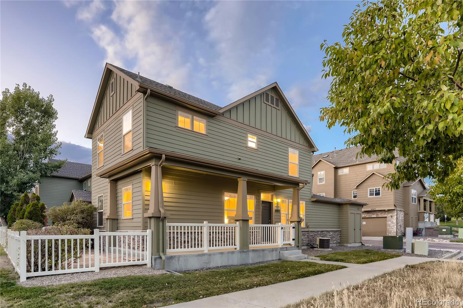 This lovely end unit in the desirable Morgan's Run community of The Meadows exudes an abundance of warmth and natural light. The unit overlooks open space from and is immediately adjacent to the walking trails of the community. Enjoy lovely views from your covered front porch or flagstone patio, both are which are surprisingly private and secluded for a condo community. The outdoor area is completely fenced and enclosed, perfect for furry family members. This home features brand new carpet, 3 bedrooms and 2 full bathrooms. The main level includes the kitchen, dining room and living room. This level also includes a bedroom and full bathroom. Enjoy vaulted ceilings as you walk up the stairs to the 2nd level. The 2nd floor contains the remaining 2 bedrooms along with another full bathroom - uniquely configured with 2 separate vanity/sink areas. You will also find the laundry room on this level (washer/dryer included).  Don't miss this home's convenient, attached 2 car garage. Enjoy all of the amazing Meadows amenities and conveniences including parks, baseball and soccer fields, volleyball courts, acres of trails, pools, clubhouses, and more included in the HOA for this home.