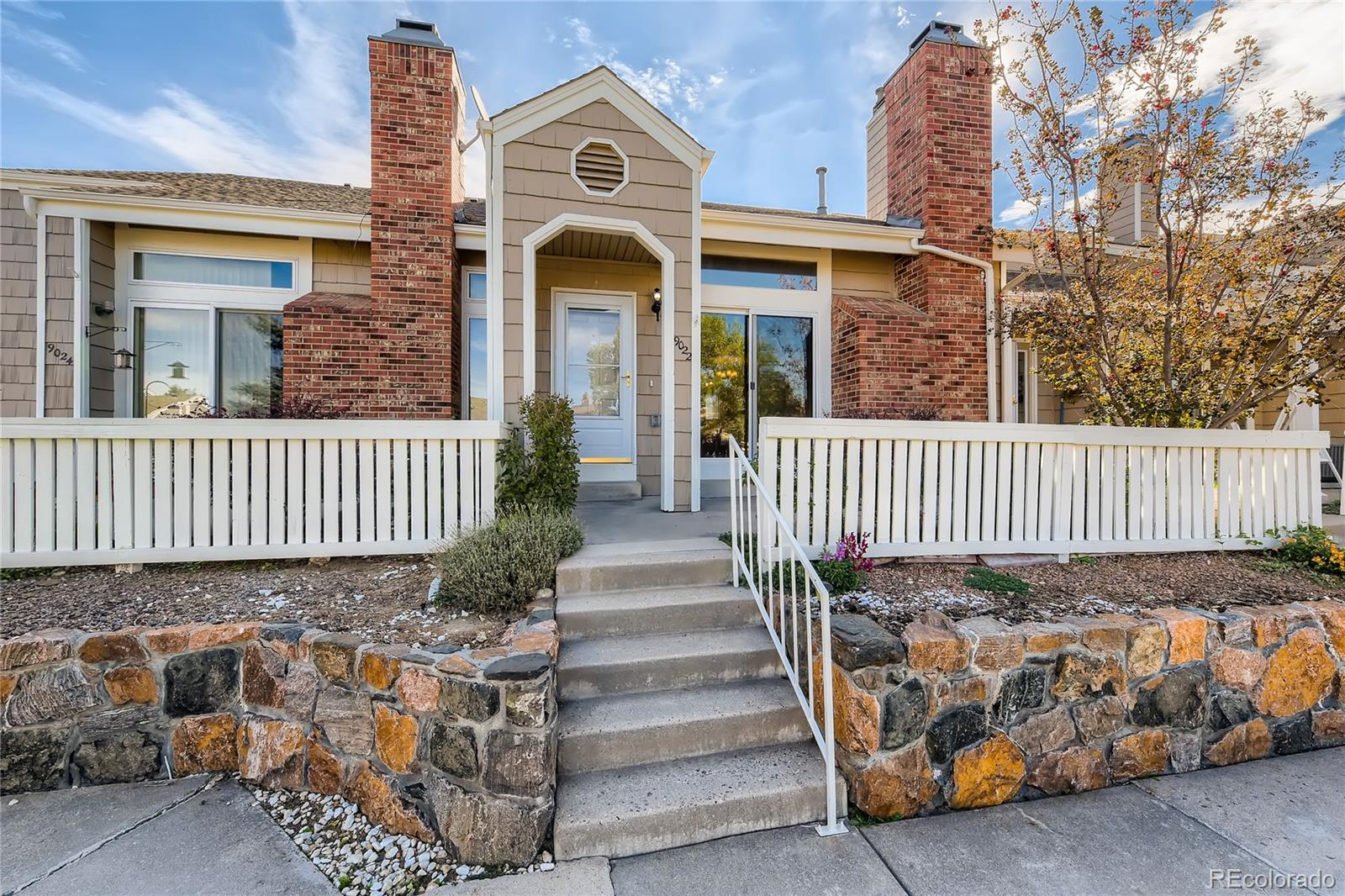 This stunning remodeled 2 bedroom, 2 bathroom townhouse is centrally located in Highlands Ranch! Fall in love when you walk into your living room that includes vaulted ceiling, a fireplace, and natural lighting cascading throughout. Entertain easily in the adjoining formal dining area that flows effortlessly to the kitchen. The gourmet kitchen is a chef's delight with stainless steel appliances, Corian counter tops, and ample cabinet space. An additional bedroom and full bathroom are on the first floor. Upstairs you will immediately notice the loft area, a perfect space to imagine your new home office or sitting room. Retreat to the relaxing primary bedroom that features an updated en suite bathroom and a deep walk-in closet. Your basement connects directly to an attached two-car garage. Use this space for your laundry room with its washer/dryer and utility sink or take advantage of the extra space for storage use or work out area. You are a stone's throw away from some of Highlands Ranch's plethora of restaurants and shopping districts, and nearby access to major roads.