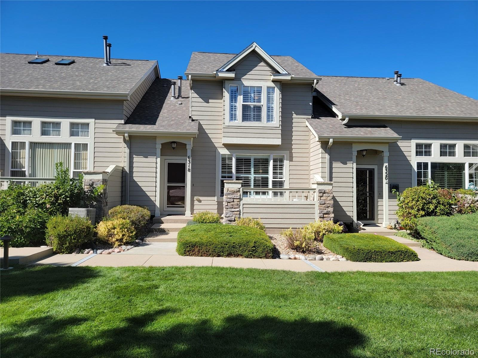 Lovely  pristine unit in Settlers Village close to with easy access to C-470, I-25 and local shopping. The main level features hardwoods, a spacious living room anchored with a gas fireplace, an immaculate kitchen with granite tile counters, Stainless stove , dishwasher and new 3 month old refrigerator. The adjacent dining room easily seats 6-8 for dinner and has bay windows and plantation shutters. The upper level offers a large master suite with vaulted ceilings, a large walk in closet and a 5 piece bath . Adjacent is a second master suite with a 3 piece private bath. All upper rooms feature Plantation shutters. The lower level has a finished bonus room with an egress window - great as an office, gym or in a pinch a non conforming bedroom. A large oversized 2 car garage with built in cabinets for additional storage completes this great townhome!!