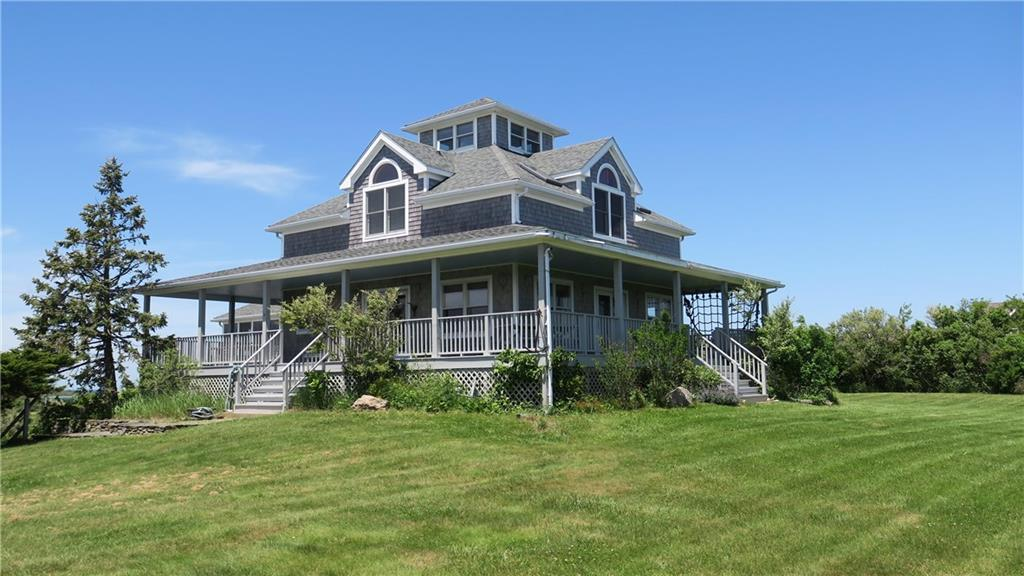 Take time to look at this perfect vacation home located just steps from Crescent Beach. Just grab your beach gear and walk on the  deeded path to the quiet beach between Scotch and Mansion beaches. Bike to town, New Harbor or just walk across Corn Neck Road to the BI Club for tennis and boating activities.  Relax on the wrap around porch enjoying sunrises and sunsets from the comfort of your own home.  This custom home features an open living area with galley kitchen, dining area, den and living room.  Pass through a sitting area and office space to a private master bedroom with full bath.  Second floor has three guest bedrooms with full bath and spiral stairway to a viewing cupola with 360 degree views of the Island and ocean.  Finished lower level is set up as a rec room large enough for ping pong or pool table with plenty of space for other games and TV viewing.  Integral two car garage for storage of bikes, beach toys and two cars.  All set on 5.1 acres of beautiful land.  A warm and welcoming home with lasting appeal.