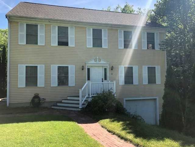 Gorgeous Colonial on Quiet Dead End Street. Spacious with 3 bedroom, Master Suite, Double Parlor, Updated Kitchen, and Partially Finished Basement with Drive Under Garage. One Acre of Land Abutting Tree Line with Above Ground Pool and Oversized Composite Deck Off Rear.
