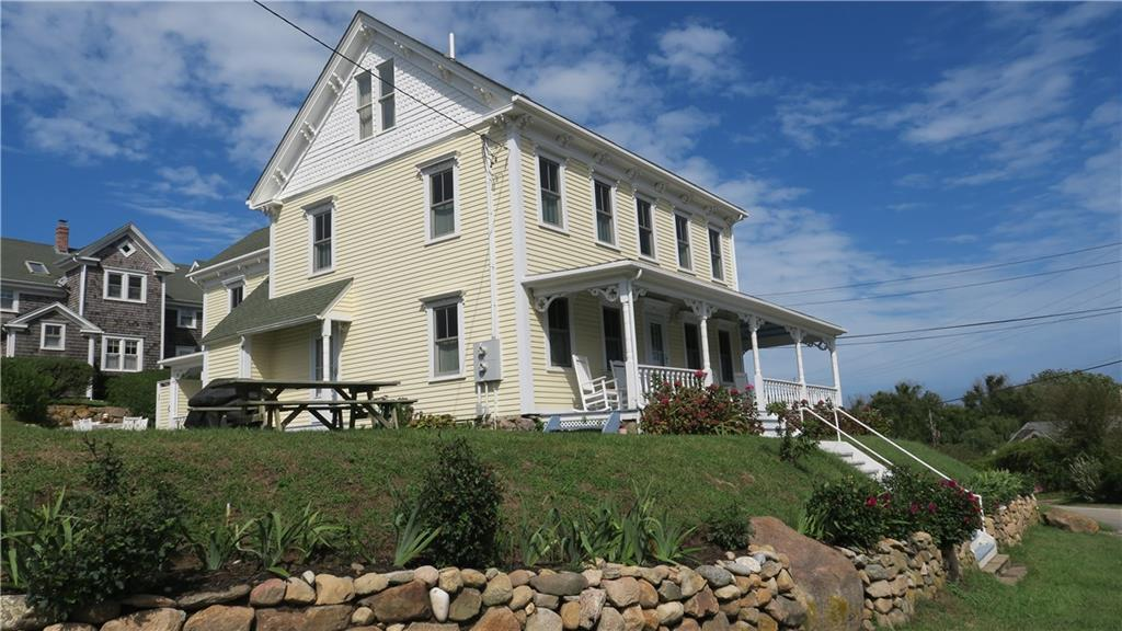 This classic 1880's Block Island Victorian home is located right in the heart of Old Harbor. It has been impeccably maintained and updated while still retaining its charm. The property offers two separate living units, with the option of renting and enjoying your vacation home at the same time, a rarity on the island! The first unit has four bedrooms and 3.5 bathrooms. The second unit has two bedrooms and 2 full bathrooms.  Gleaming hardwood floors throughout both units. Two gas fireplaces, to make cozy nights.  Crown moldings, trim, stained glass window and gingerbread decorative woodwork, evoke the style of a bygone era. Lovely covered porch and decks, to sit outside and watch the Old Harbor activities. Ocean views of the harbor to Clayhead can be enjoyed from the top two levels. Take advantage of this prime location on Calico Hill, walk to shops, restaurants, beaches and the ferry.