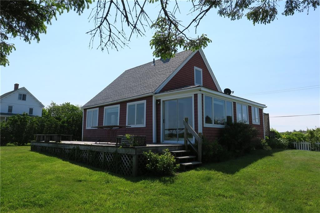 One of the oldest homes on Block Island.  Wonderful 3 story barn behind it.  Huge views of Great Salt Pond.  Set back from the road with nice big yard to play in.  Views out the back of Trim's Pond too.
