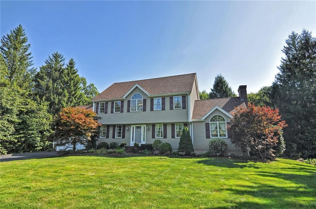 A Stunning Custom Built 3 Bedroom Colonial In A Highly Sought After Neighborhood On A Lush Private Corner Lot With Meticulously Maintained Grounds. Upon Entering Through The Grand 2-Story Foyer You Will Find An Open Floor Plan, Perfect For Entertaining, Gleaming Hardwoods Throughout, A Custom Kitchen With Granite Countertops And Newer, High End SS Appliances Which Abuts The Breakfast Nook That Leads To The Back Deck; A Dining Room & Formal Living Room W/ French Doors & Beautiful Moldings, and A Large 1st Floor Laundry Room. The Sun Drenched Family Room Showcasing A Fireplace W/ A Custom Floor To Ceiling Mantle, And Cathedral Ceilings. Upstairs You Will Find A Large Master En-Suite W/ Cathedral Ceilings, A Large Walk In Closet & Master Bath; As Well As 2 Additional Bedrooms And  Full Bathroom. Some Upgrades/Features Include: New Roof and Siding, Irrigation, Surround Sound, C/A, Water Filtration System,Custom Windows, Invisible Fence & So Much More! Attention To Detail Throughout. Prime Location!