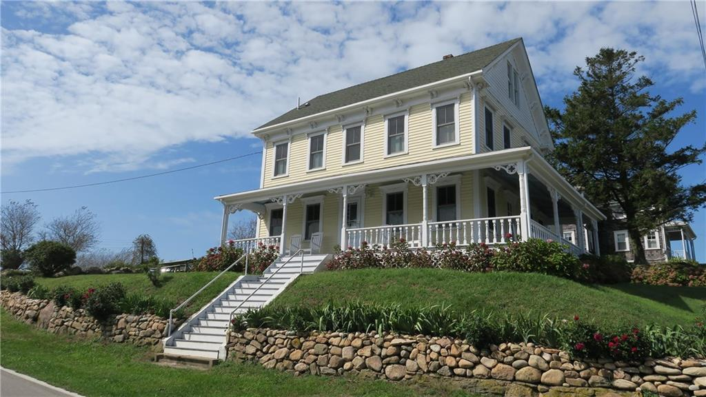 This classic 1880's Block Island Victorian home is located right in the heart of Old Harbor. It has been impeccably maintained and updated while still retaining its charm. The property offers two separate living units, with the option of renting and enjoying your vacation home at the same time, which is truly a rarity on the island! The first unit has four bedrooms and 3.5 bathrooms, Living/Dining/Kitchen and is very spacious at a little over 1750 sq ft. The second unit has a first-floor bedroom, Living/Dining/Kitchen shared full bath and a second-floor master suite with Jacuzzi tub, fire place and private deck.  Gleaming hardwood floors throughout both units. Two gas fireplaces, to make cozy nights.  Crown moldings, trim, stained glass window and gingerbread decorative woodwork, evoke the style of a bygone era. Lovely covered porch and decks, to sit outside and watch the Old Harbor activities. Ocean views of the harbor to Clayhead can be enjoyed from the top two levels. Take advantage of this prime location on Calico Hill, walk to shops, restaurants, beaches and the ferry.  Solid rental history, this property is a must see!