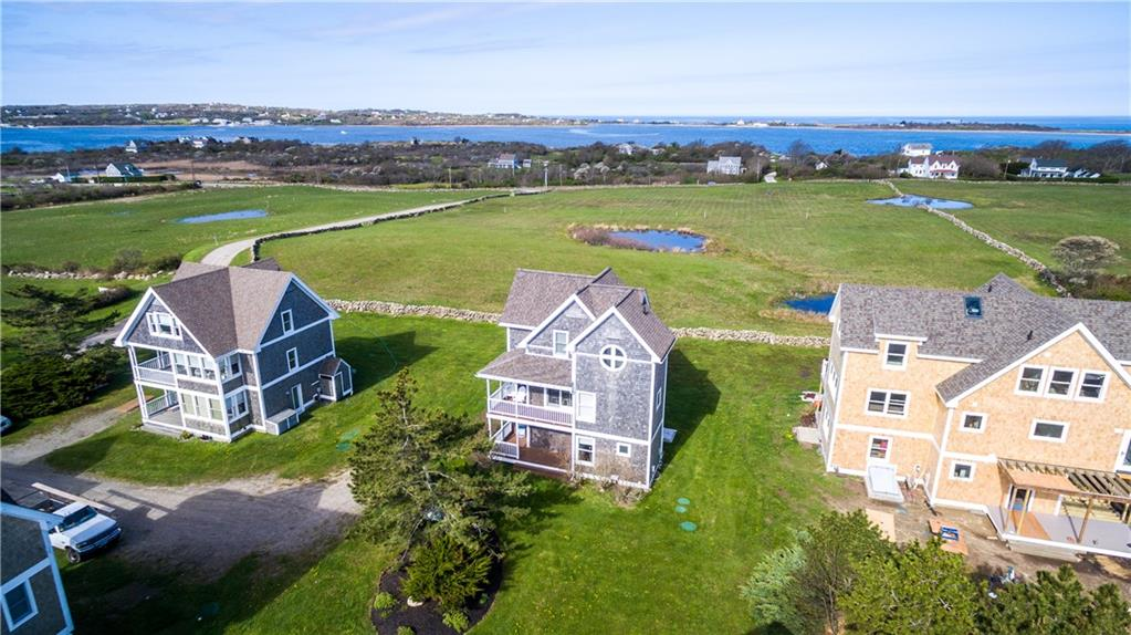 Experience seaside living just steps from the best stretch of beach on Block island!  Set against the backdrop of the Atlantic Ocean to the east and with expansive views of New Harbor and lovely, preserved meadows to the west, family and friends will love the Crescent Beach Association community.  Offering direct beach access, proximity to New Harbor and an easy jaunt to town, this is an unbeatable location!  Fully winterized for year round enjoyment, with an open floor plan that is perfect for entertaining.  Expansive decks on the first and second floors capture the fun of outdoor summer living.  A private master suite and great guest accommodations make this the perfect get away!