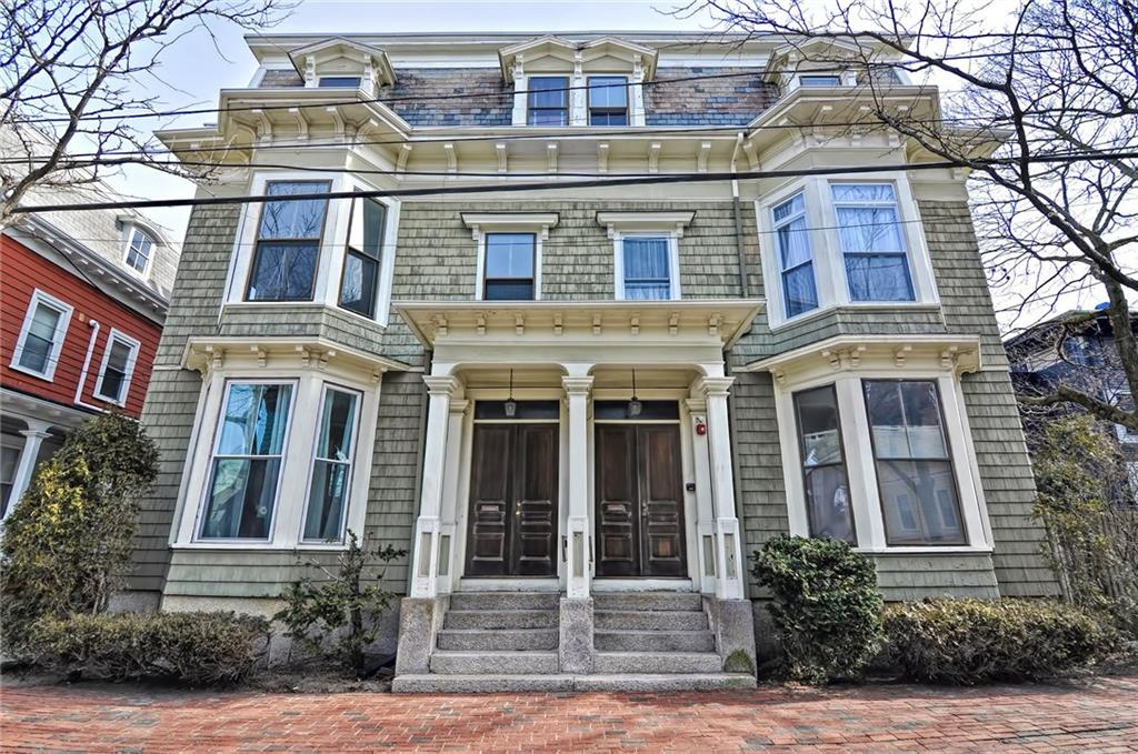 This is it! Top level, penthouse condo in one of historic Federal Hill's Mansard Victorians! Enjoy living within walking distance to everything Providence has to offer in a home with all of the charm of the past and conveniences of today. The sun-drenched eat in kitchen has new granite counters and lots of counter space which is great for preparing the perfect meal for friends and family!  The family room features a wood burning fireplace and gleaming hardwood floors flow throughout the entire home. The newest improvement is the fully renovated bathroom with luxurious custom time shower and seamless glass enclosure. Private laundry room with new and included washer and dryer, Private storage space in basement. Deeded off-street parking and the exterior is being painted this Spring. Location is everything!