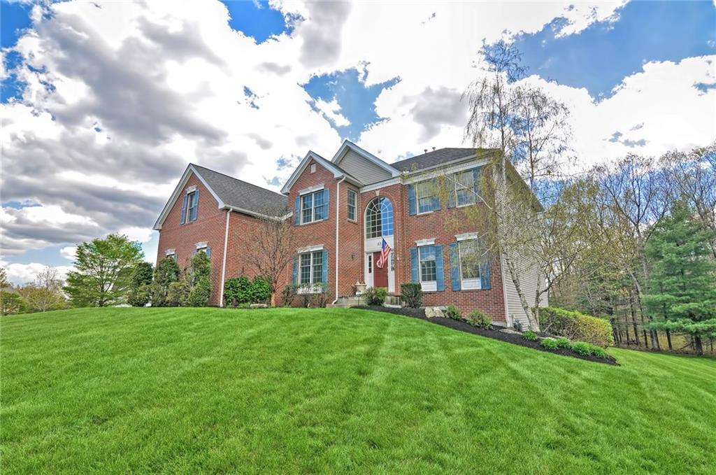 Welcome home to this magnificent colonial in Bellingham Estates. Featuring a two story family room with vaulted ceilings, and oversized windows capturing unobstructed southern views of nature. Immediately greeted by a grand foyer with a dramatic staircase, open concept kitchen and family room. Natural gas fireplace and additional stairwell for convenience of upper story. Kitchen features cherry cabinets with upgraded white spring granite countertops, stainless steel appliances and wine refrigerator. Formal dining area with open concept to additional sitting area. Oversized three car garage and walkout basement. Premium lot and beautifully landscaped yard featuring custom made Pergola over deck, perfect for entertaining during those warmer summer months. Quiet neighborhood and pride of ownership, be sure to reserve a tour of this home soon!