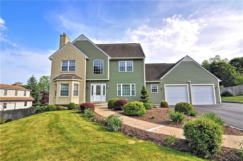 Absolutely Stunning & Meticulously Maintained Custom Built Colonial Perfectly Situated on Nearly an Acre! This Lovely Home Features a Gorgeous 2-Story Foyer, Open Floor Plan, Custom Kitchen with Granite Countertops, Double Wall Oven, Large Center Island & Breakfast Area Leading to a Front to Back Living Room Featuring a Gas Fireplace - Perfect for Entertaining! Convenient First Floor Laundry/Mudroom & Full Bathroom, Unique Plant/Sunroom, Large Formal Dining Room, 3 Spacious Bedrooms Including a Luxurious Master Suite Featuring Walk-In Closet and Spa-Like Bathroom with a Jetted Tub, Double Vanity & Separate Shower! Other Features Include Central Air, Hardwood Floors, Nicely Finished Lower Level Complete with a 2nd Kitchen and Dining Area, Family Room & Plenty of Storage! Expansive & Well Manicured Yard with Large Exterior Deck and an Impressive 3 Room Outbuilding Featuring Large Workshop, Separate Kitchen Area & Additional Storage! Outdoor Oven, Vegetable Garden & Vineyard Complete this Incredible Property! Simply a Must See to Truly Appreciate! Call Today for Your Private Tour!