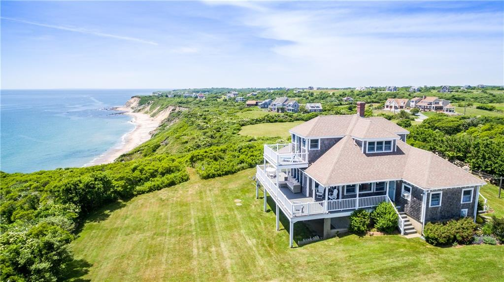 Enjoy the timeless appeal of Block Island in this classic, shingle style bungalow situated on 6 acres of waterfront land.  It is easy to imagine gathering for milestone celebrations, holidays and memorable vacations in this enchanting home.  Enjoy commanding views of the Atlantic Ocean in all directions and a shared staircase to marvelous, Bluff Beach.  You'll be comfortable year round--in the summer with cooling ocean breezes or settled by the cozy fireplace during the off season.  Recent interior updates make this home ready for your immediate occupancy and enjoyment.