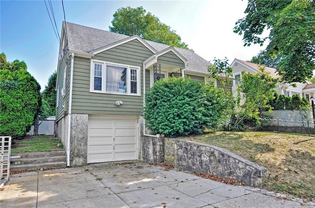 This charming and meticulously kept cape, conveniently located in the center of Johnston, offers many beautiful updates throughout, including recessed lighting, an electric fireplace and a gorgeous kitchen featuring granite countertops, island and stainless steel appliances. Plenty of natural light and hardwoods throughout. This home features spacious bedrooms on the first and second floors, custom built in storage space and a finished basement with an updated full bath. A newly added family room allows for a second entertaining space with sliders to backyard. Large fenced in yard is equipped with french drains, is ready for gardening and has a spacious shed for extra storage.