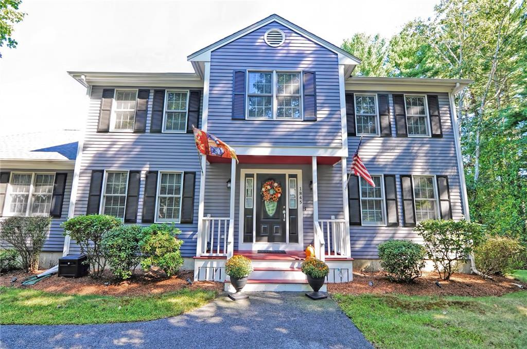This stunning custom Colonial is not only in a beautiful and established neighborhood but it also features lots of potential living options with and abundance of space and an amazing floor plan! Welcome to 1845 Pine Hill Road! This absolutely gorgeous home features a very spacious granite kitchen with breakfast peninsula seating, stainless appliances an abundance of cabinet storage and breakfast nook! The open and versatile floor plan gives you an entire 600+ SQUARE FOOT GUEST OR IN-LAW SUITE all on the first floor- a full kitchen, living room, bedroom and full bath! Main house features another 4 bedrooms and 2.1 bathrooms. All rooms are spacious and bright.  Freshly painted rooms and hardwoods throughout first and second. Partially finished lower level with mudroom upon entering from garage for more potential space to finish in the future! All of this nestled on exactly one acre of well manicured land in Briarwood Estates! This well appointed home is a must see- schedule a tour today!