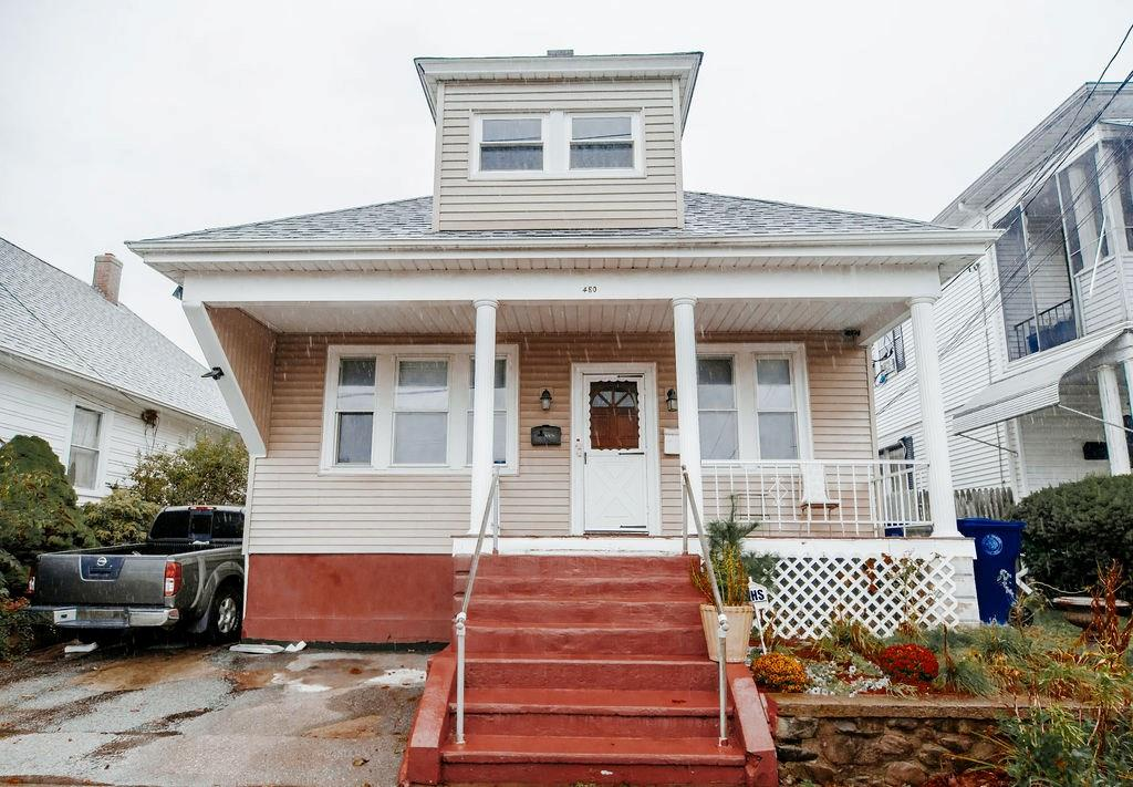 Beautiful 2 Family Home in Cranston. Perfect for owner occupant. 3 bedrooms and double parlor in each unit. Home offers a lot of updates including the roof, heating, baths, siding. Beautiful hardwood floors. Extra finish living space in the lower level as well. Will not last !!!!