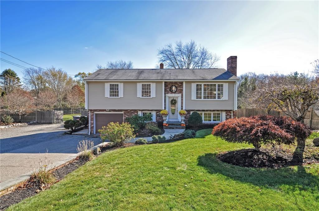 Have you been looking for the perfect Seekonk home that will make everyone happy? This is it! This home has something for everyone as the main house features an updated kitchen and baths,a massive and private fenced yard AND an absolute dream 4+ car detached/heated 20x60 garage with plumbing AND a 30x40 canopy structure for storing more recreation vehicles/campers/equipment. The kitchen is beautiful and open with new quartzite counters, island seating, stainless appliances and dining area. The kitchen is open to the family room with hardwoods and bay window. The open floor plan is beautiful with an abundance of natural light, hardwood floors and an incredible 20 x 21 bonus family room in the lower level with fireplace, wood burning stove and half bath. This almost exactly 1 Acre lot is level and open, fully enclosed with a large patio and fire pit area, playset and mature landscaping. Must tour this home to appreciate all it has to offer! Call to inquire for more details and a tour!
