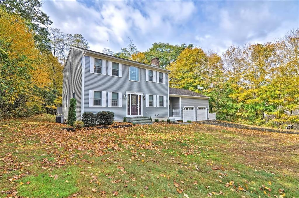 New Price! If you're looking for move in ready and privacy, your home search stops here! This beautiful colonial features gleaming hardwood floors, stainless steel appliances and brand new paint inside and out! Crown molding throughout dining and living area. Kitchen has upgraded granite counter-tops and contemporary back-splash. Spacious bedrooms and two car garage. Walkout basement and the ability to finish. This home is set back from the road for added privacy and surrounded by almost two acres of land. Come schedule your home tour today!