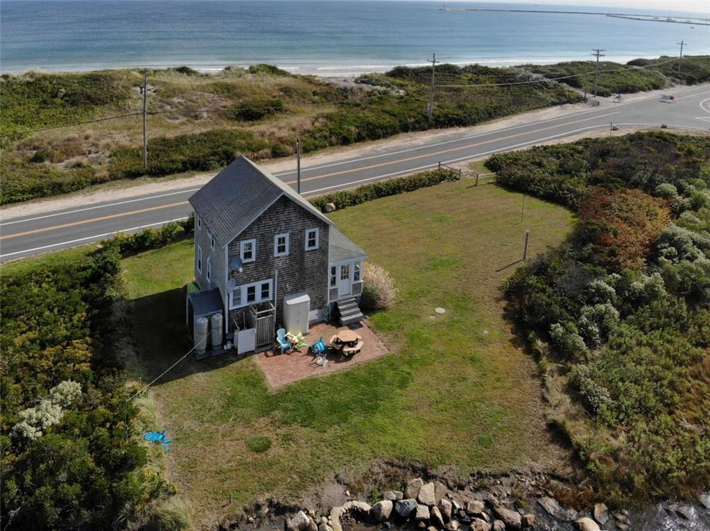 Historic waterfront cottage backing up to the Great Salt Pond estuary and across from Crescent Beach. All new windows. three season cottage with gas heat. Paddle out your back door; swim out your front door! Enjoy the sunrise; enjoy the sunsets. Charming old time cottage!