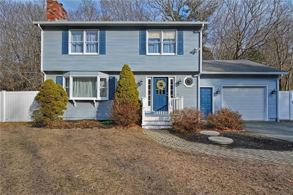 You won't want to miss this well-maintained East Greenwich Colonial home that sits on just over an acre; complete with garage, huge yard and plenty of privacy all while being in close vicinity to I-95, I-295, RI Rt2 & Rt4! The living room offers a huge bay window that drenches the whole room in natural light from the crown molding to brick fireplace to the freshly refinished gleaming hardwood floors! The eat-in kitchen features stainless steel appliances, recessed lighting, and a slider allowing access to a blissful backyard. The backyard is completely fenced in and touts a large composite deck perfect for grilling, a stamped patio sitting area, and plenty of space to spread out and enjoy yard games. Upstairs you will find the master bedroom with a walk-in closet, 2 additional bedrooms and an updated full bath with beautiful tile work. The basement is finished and offers a wonderful bonus space to hang out, exercise, have a playroom, office, or just for extra storage! Other features include a formal dining room, central a/c, new septic in 2015, half bath & laundry located on the first floor, new gutters w/screens & new garage door. It's truly amazing the amount of love, care, and attention to detail that has been put into this home! Sale contingent on Seller's finding suitable housing.