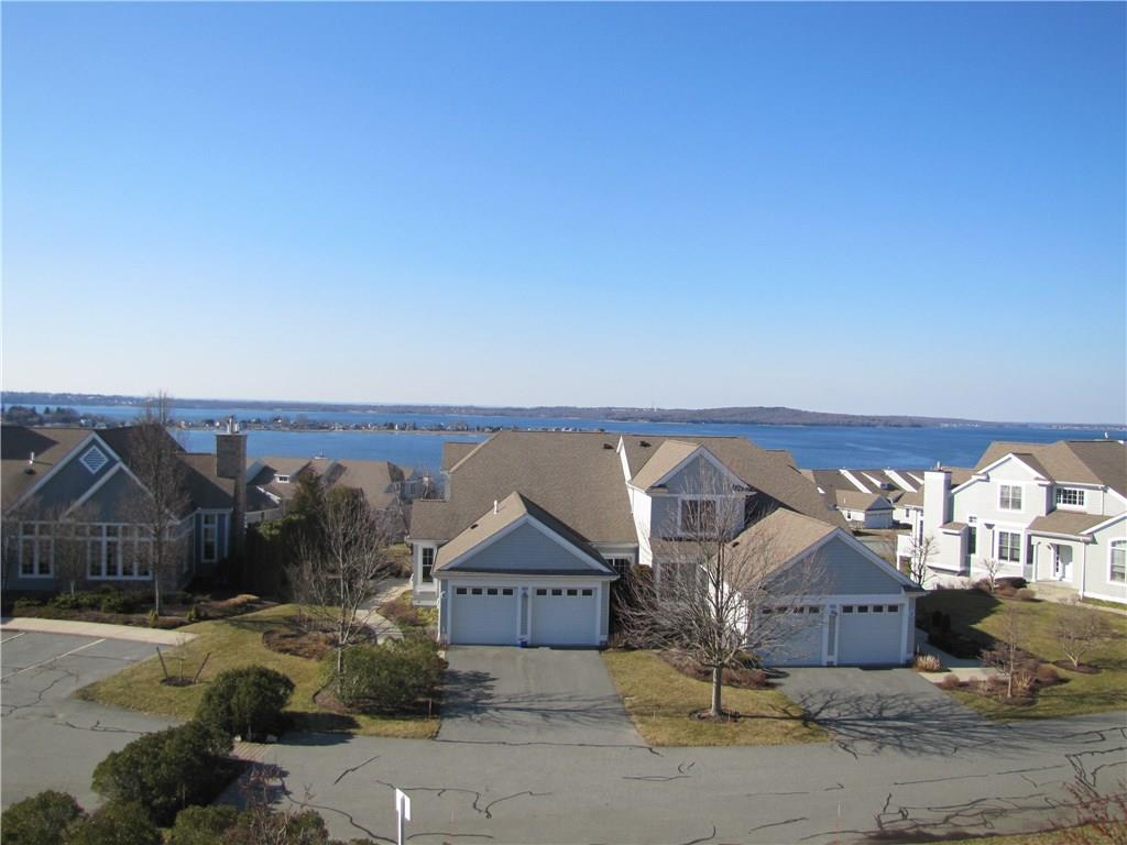 Rare rental opportunity at the Villages Mt. Hope Bay!  This waterfront condo with open floor plan and amazing views of the Mt. Hope Bridge is currently available for lease. Featuring a chef's kitchen, blue pearl granite, open floor plan, hardwood floors throughout, spacious dining room, fireplace living room that opens to an oversized deck. This unit features a 1st Floor Master Bedroom with Mater Bath and sliders to deck, 1st floor laundry and 1 car garage.  The lower level features spacious bedroom with sliders to patio, office area, and great room.  Lower level also features a full bath with oversized walk in shower, tub and double vanity.  Economical gas heat and central air.  Access to community pool, clubhouse, gym, tennis, walking trails and more.  This is an over 55 Community.  Call for more details and spend the summer on the water and enjoy all the beauty and activities the area has to offer!