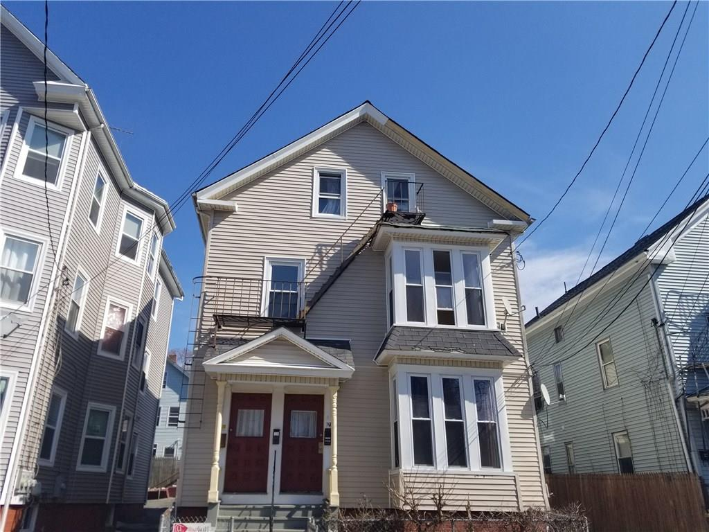 Spacious 2 family home in Smith Hill. 1st floor has three bedrooms and the 2nd and 3rd floor are combined to make up a large 5 bedroom unit.  Updated electrical entire home. Hardwood floors through the home as well. Good parking for each unit. We will accept FHA offers or conventional offer.