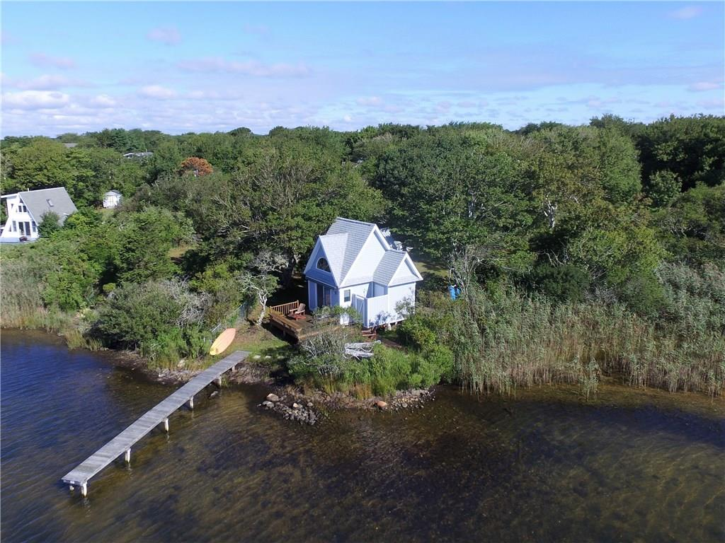 This 1952 waterfront fishing cabin has been completely updated and renovated into a modern day beach cottage. Located directly on Green Hill Pond, this home is well protected from the open ocean and has the most amazing unobstructed views of the pond, beach and ocean beyond. With its wonderfully unique roof lines, this private oasis encompasses a bedroom loft, bathroom, kitchen and sitting area - all with a perfect view of the water. Sitting out on the waterside deck, you can't help but feel like you are a part of all the wildlife that surrounds you on the pond.     Currently used only in the summer months, the cottage is fully insulated with electric heat making it a possible year-round home or vacation spot. The potential to add a full second story or even build a new waterfront home on the property may be possible. Don't let this one get away!