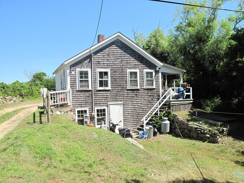 Wonderful opportunity for a buyer to own a peaceful piece of Block Island.  Nicely located on a private lot near the town, school and Medical Center.  Walk to town and the Mohegan Bluffs.  Open living, dining, kitchen and two bedrooms, one bath on main floor.  Walk out basement on lower level.  Full attic.  Distant views of Clayhead and Atlantic Ocean.  Abutting Conservancy land on three sides.