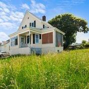 Amazing potential, 3 bed, 1 bath,  family home, completely gutted. Two sun porches, and some water views!  Great lot and neighborhood. Sold in as is condition.