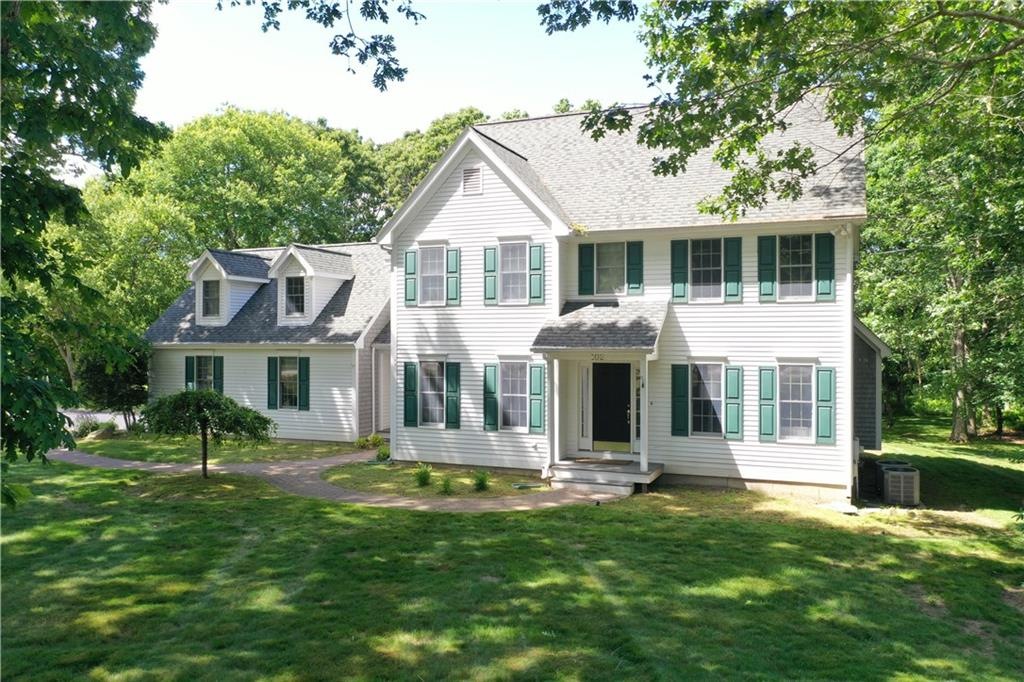Space abound in this sprawling colonial in the Saunderstown area of North Kingstown! This young home contains four beds and three and a half baths. Three floors of finished space! On the main floor a beautiful open kitchen with dining area, a large family room, a formal living room, and a formal dining room. Upstairs you'll find a master suite with enormous bath (jacuzzi tub, double vanity, shower) and a walk-in closet. Three additional bedrooms, an additional bathroom, and second-floor laundry area. On the lower level is even more space containing a finished basement with office, family room, wet bar and full bath! Outside you'll see beautifully landscaped grounds on a corner lot, deck and patio, and 2-car garage! Come see all this home has to offer! Book your private tour today!