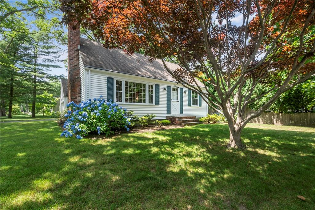 * Highest and best offer due by Monday July 13th at 5pm!*  This charming 4 bedroom, 1 1/2 bath Cape sits on a beautifully landscaped corner lot in desirable Hampden Meadows! The interior features hardwoods throughout both first and second floors and a freshly painted interior with neutral modern colors. The kitchen features stunning cherry cabinets, new flooring and lighting. The central focus of the spacious family room is the wood burning fireplace with brick surround and custom built-in shelving. Over-sized two car garage and a sun filled sun room which overlooks a garden just outside the kitchen window. The convenience of this location is incredible as it provides quick and easy access to major highways and shopping while still offering all the advantages of living in beautiful Barrington, Rhode Island!