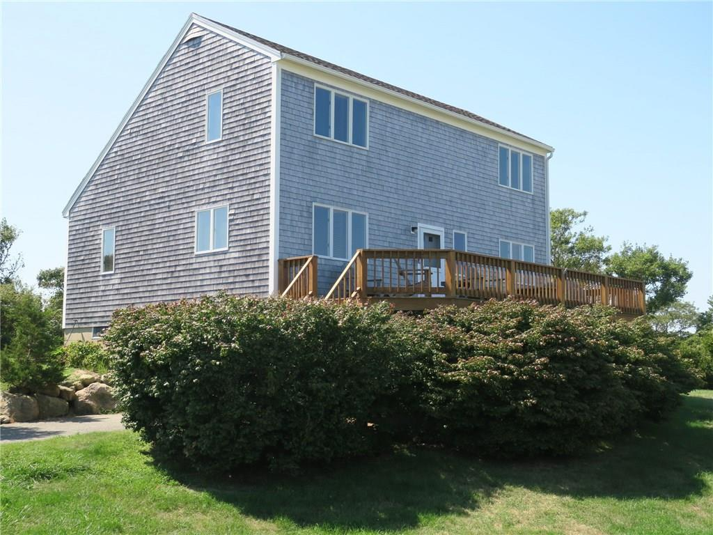 Amazing views of the Atlantic Ocean, Clayhead Bluffs and Rhode Island shoreline from this spacious Saltbox home.  This single-owner home has been impeccably maintained, loved and enjoyed by the family for many years.  The main floor has a expansive open living/dining/kitchen, two good sized bedrooms and full bath.  The second level features a master bedroom, second bedroom and shared full bath.  Lower level offers plenty of storage space for beach and Island gear, laundry area and garage large enough for two cars.  This is the perfect property for aviation fans as you can view planes as they take off and land on the single runway.