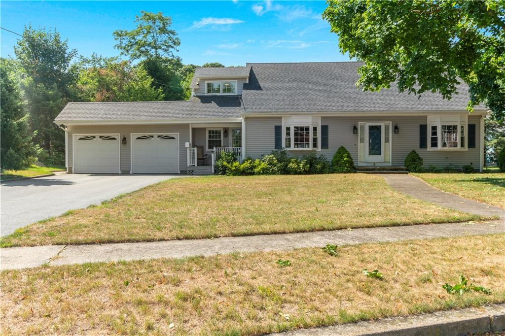 Welcome Home! This Expansive Cape has Everything you Want in Location and Privacy.  Situated at the end of a Cul-de-sac in the Heart of Cowesett, You Will be Close to Everything, Including Main St. East Greenwich and Waterfront, Route 2 and Just Over 10 Minutes to Garden City! There is Over 1 Acre of Land, and with 2,600 SF of Living Area, There is Ample Space for Family and Friends Inside and Out.  On the First Floor, There is Plenty of Room to Relax or Entertain in the Open Living and Dining Area.  In Addition, There is a 2-Story Den on the Main Level with Fireplace.  French Doors Abound and add Charm and Character to the Classic Cape Style.  Kitchen, Laundry, Mudroom and Garage Access are all on the Main Level as Well as 2 Bedrooms and a Full Bath. Walking Upstairs, You Land on a Balcony Overlooking the First Floor Den. There is also Large Guest Bedroom, Full Bath, and Enormous Master Suite on the Second Floor.  Connected to City Sewer and Water, Ductless A/C, Vinyl Siding and 6 Year Old Roof. Per COVID-19, by Appointment Only.